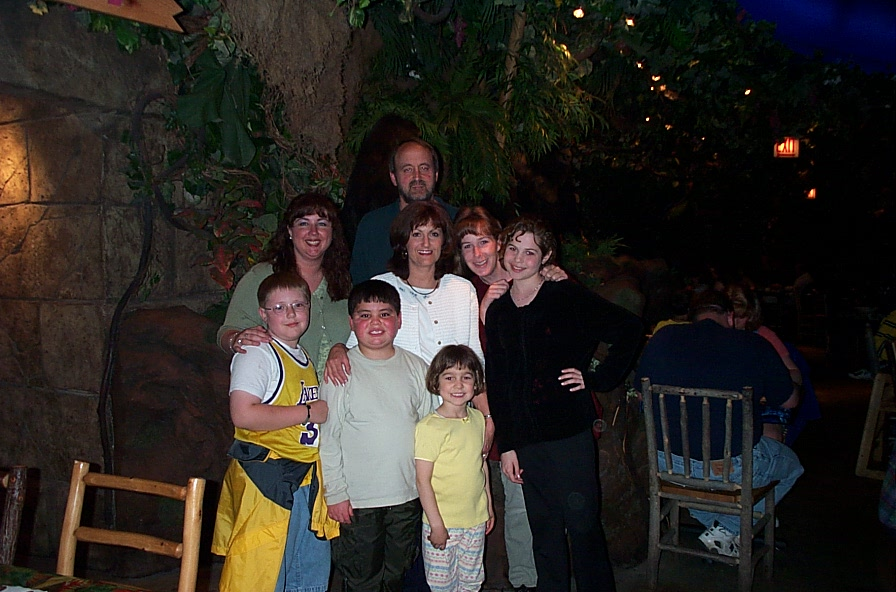 Jackson, Trevan, Jenna, and Jillianne (front row) at Rainforest Cafe (Kristen, Nancy, Mike, and Kelly - back row))