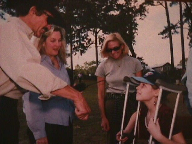 Jillianne with Kyle Petty and his wife at the 1999 Boggy Creek Gang Camp Christmas party!!!!  WOW!!!!